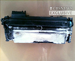 Handout image shows a toner cartridge discovered aboard a cargo plane in East Midlands, north of London, Friday.