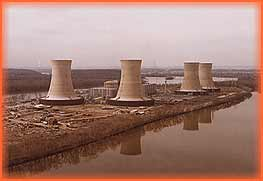 Four cooling towers symbolize the nuclear industry. Cooling is needed to reuse water that makes steam.